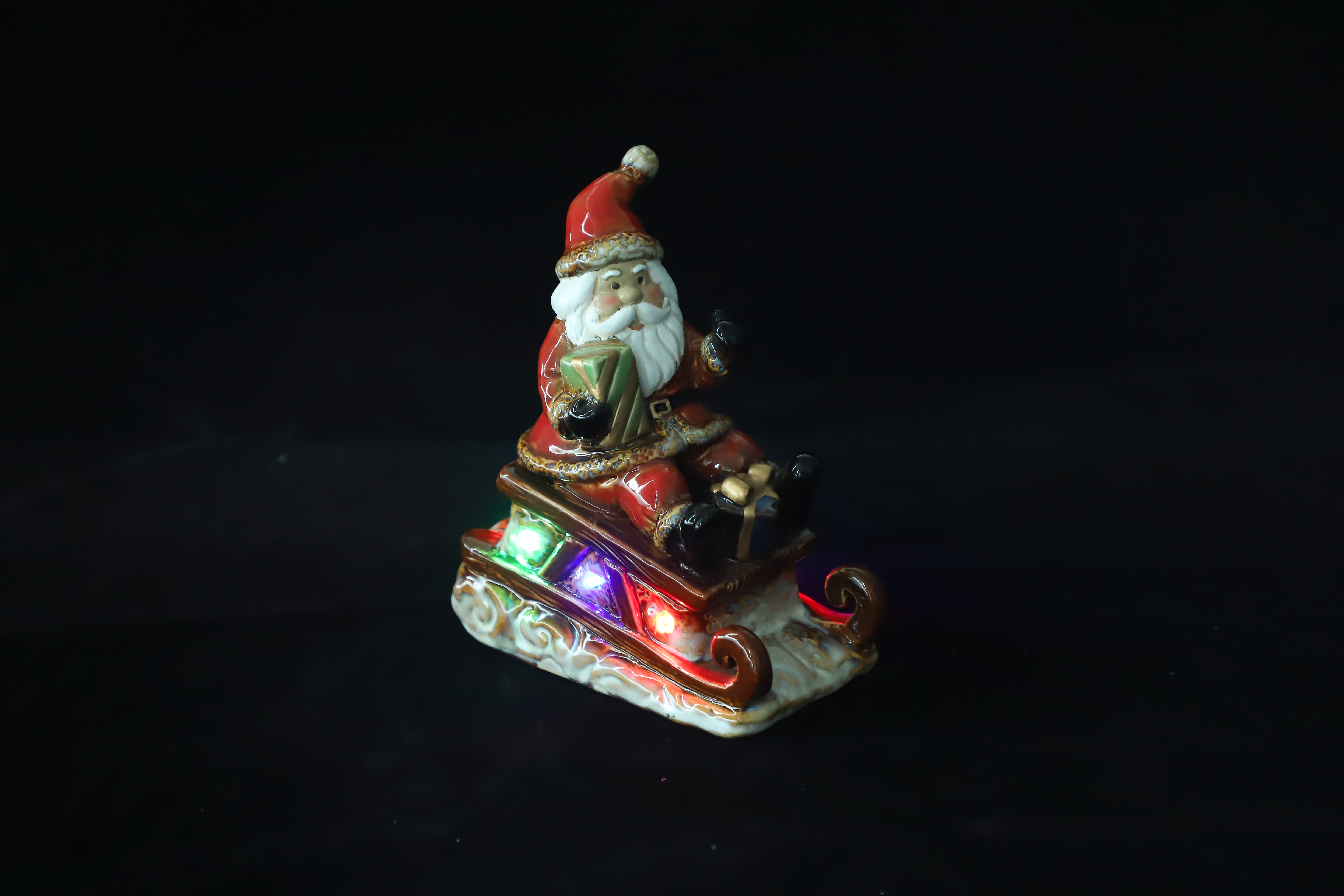 Lighted Festive Christmas Santa Sitting in Sled